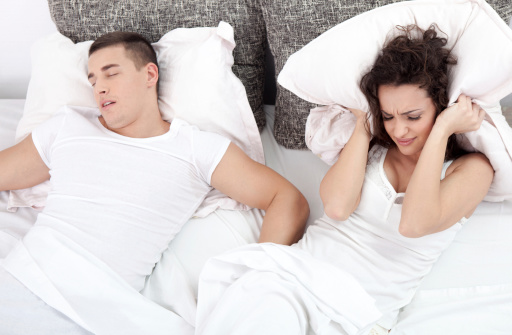 Woman unhappy with her husband's snoring.